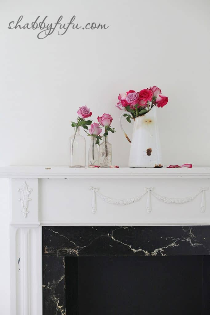 five minute design tips - pink rose flower arrangements in vases on a white fireplace mantel
