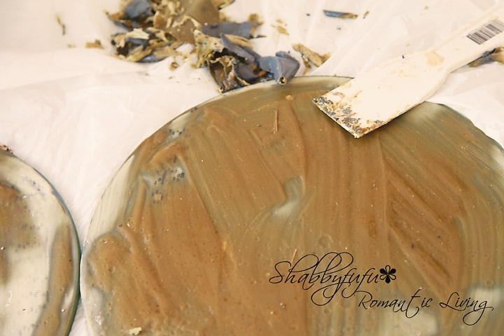 Step by step DIY mirror patina tutorial - putting the varnish stripper on the back of the mirror.