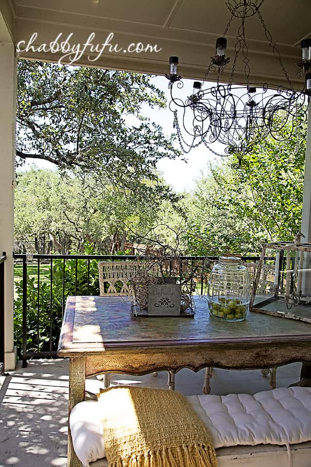 French country decor in Texas - outdoor porch overlooking yard landscaping