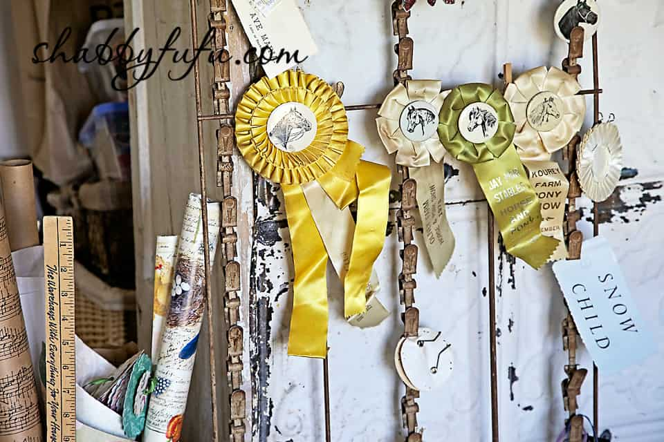 French country decor in Texas - ribbons and awards from horse show in a shabby chic french country design studio