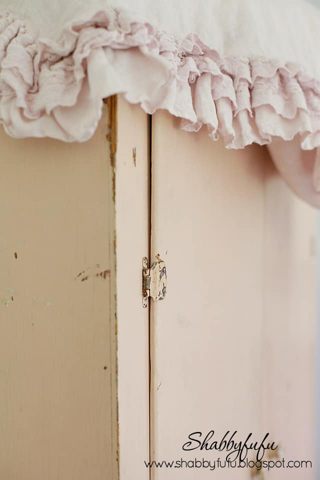 Distressed details of our vintage pink linen cabinet - chipped paint in perfect places