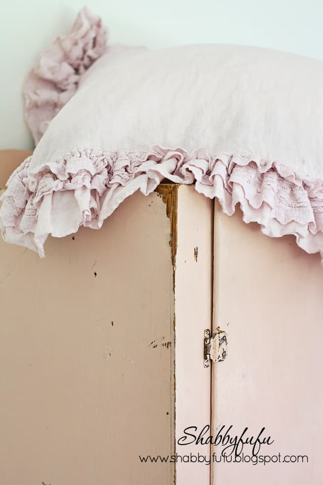 Pink frills and soft fabrics feel at home housed in this vintage pink linen cabinet