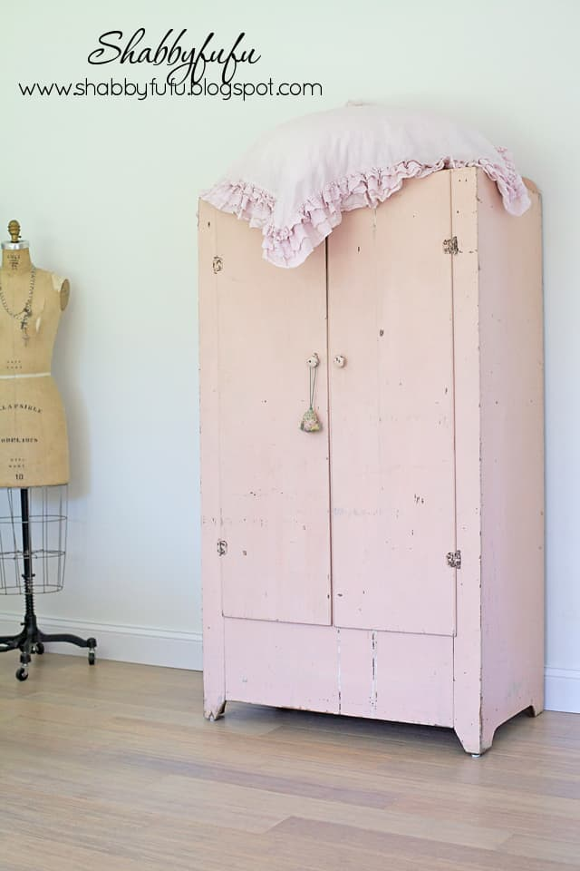 This vintage pink linen cabinet is a statement piece in our master bedroom and adds much needed storage space!