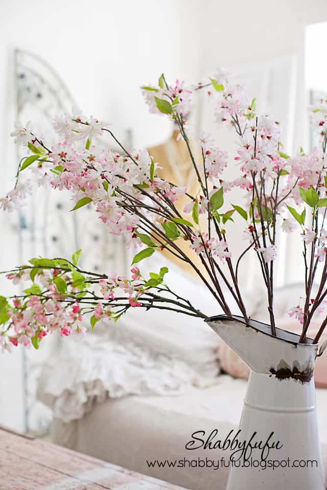 These faux pink blossoms are perfect pink accents to complement the light color of the vintage pink linen cabinet