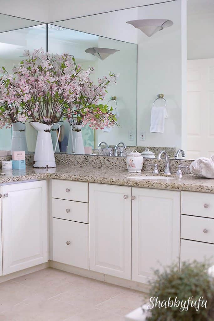 white shaker cabinets and granite bathroom