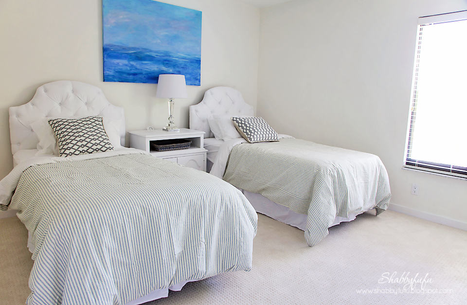 guest bedroom transformation - after! Two twin beds with white and light green striped bedding