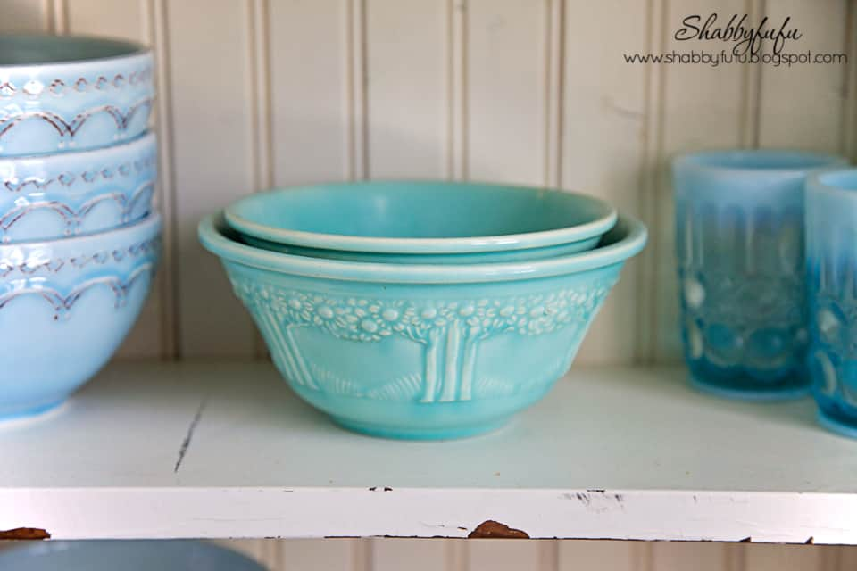 Adding pops of color to a room - light blue and teal serving bowls