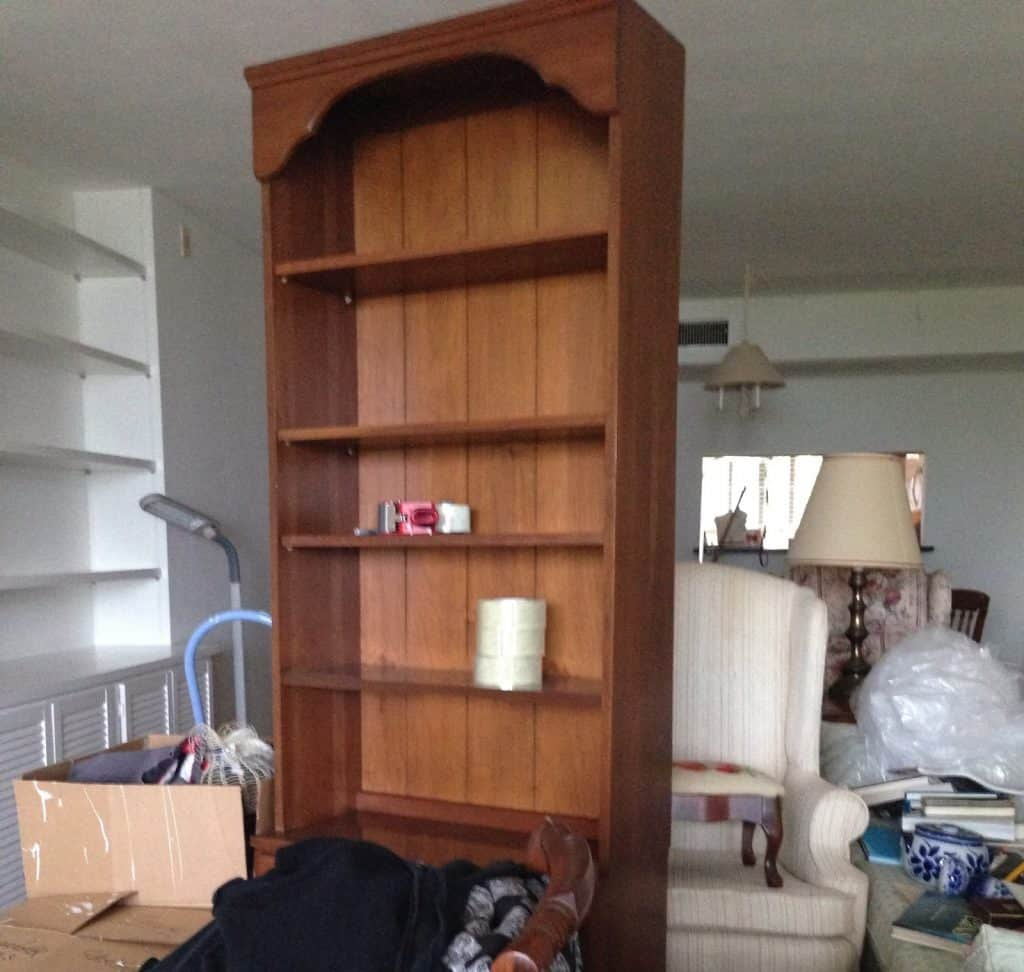 guest bedroom transformation before - cluttered and dysfunctional furniture we donated