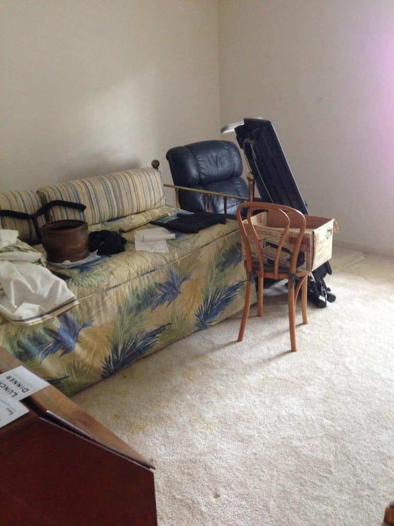 guest bedroom transformation - before - cluttered and dysfunctional furniture we donated