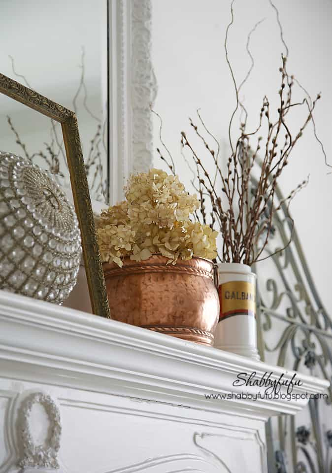 fall decorating inspiration - gold and brown decoration on a white mantel
