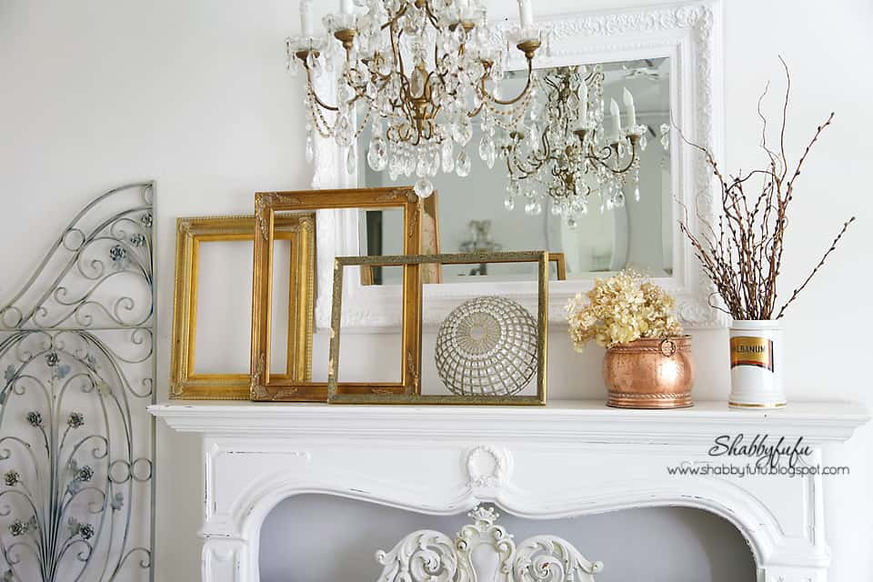 fall decorating inspiration - gold picture frames on a white mantel