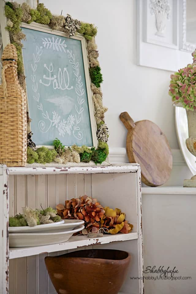 All fall vignettes aren't complete without rich fall colors, some seasonal flowers, and a cute chalkboard with a fall display!
