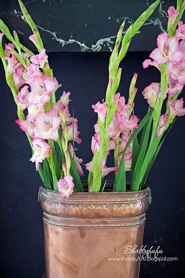 flowers in a copper bucket