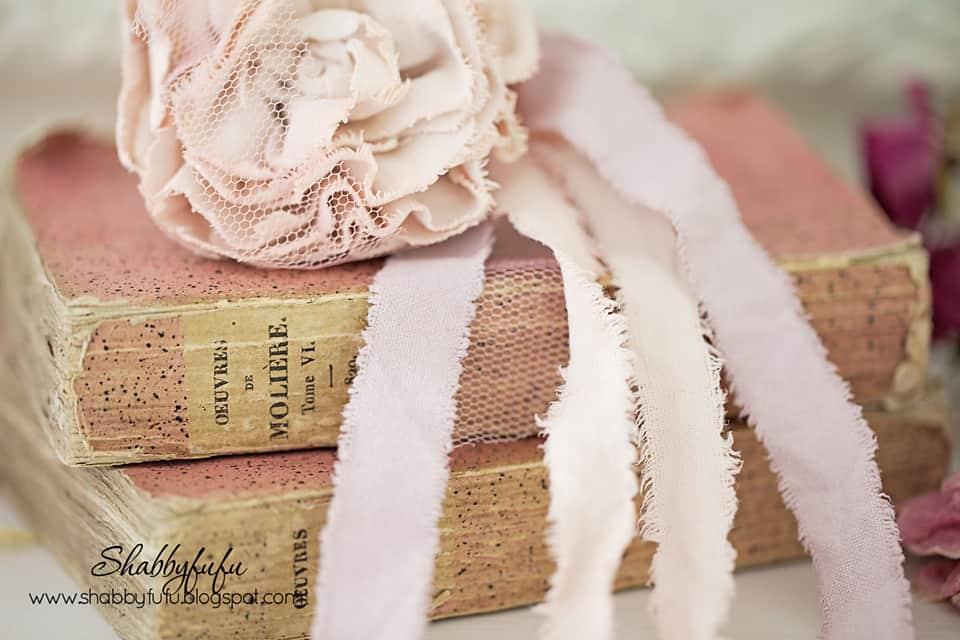 pink linen flower on books