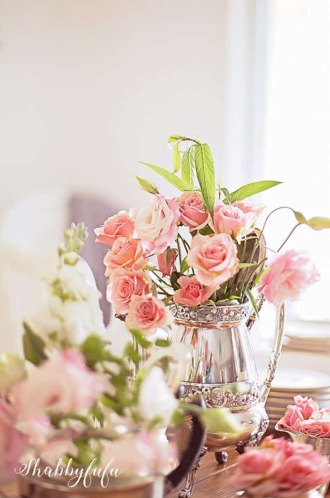 blush pink roses in a silver coffee pot - pretty fall decorating ideas