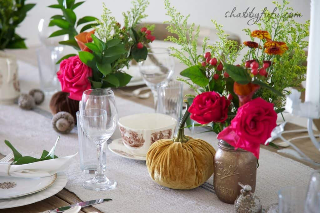 Thanksgiving Beach House decor tablescape with fall flower arrangements and colorful centerpieces