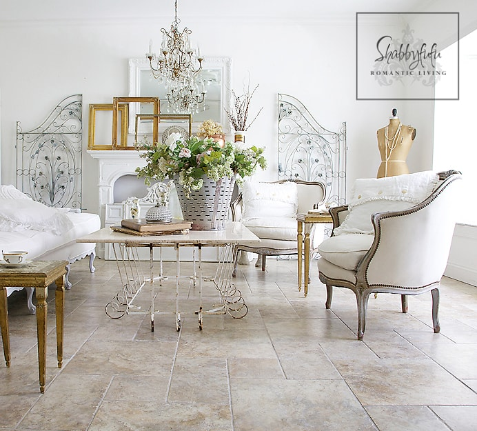 decorating with white - this sitting room is all neutral with white fabric and gold and silver accents