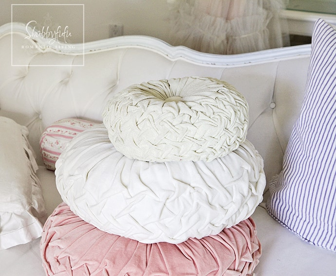 When you mix and match throw pillows you can gather similar textured pillows like this trio of pastel pink, white, and green throw pillows.