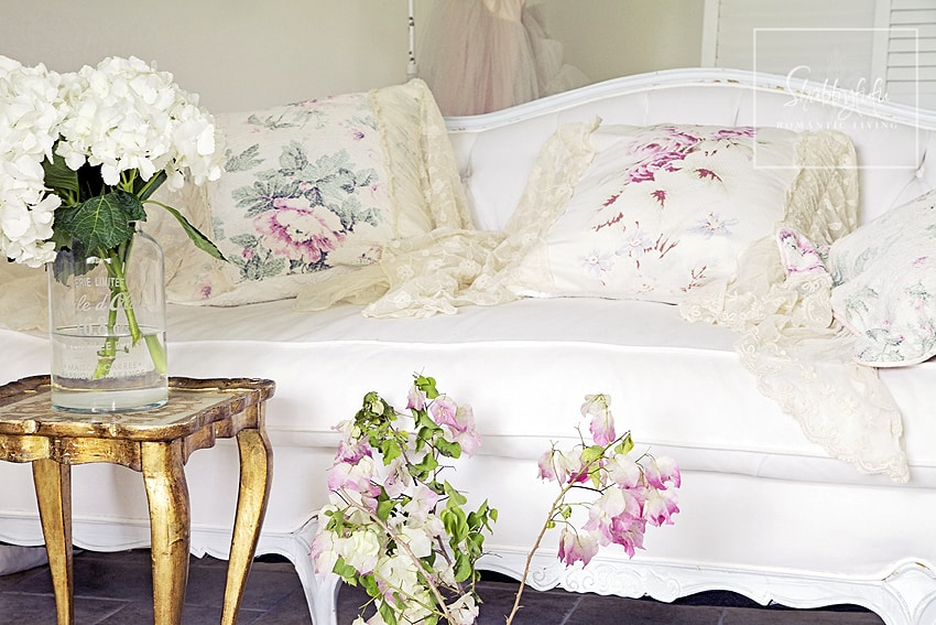 mix and match throw pillows is easy if you keep different textures and colors in mind. These floral pillows are a perfect mix of white, cream, and neutral colors.