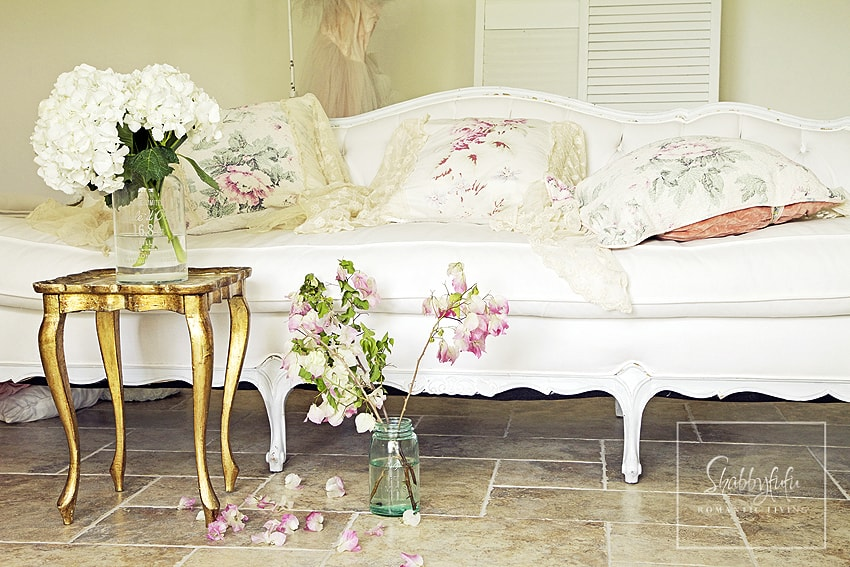 We mix and match throw pillows on our neutral colored furniture and use soft floral patterns for a pretty elegance.