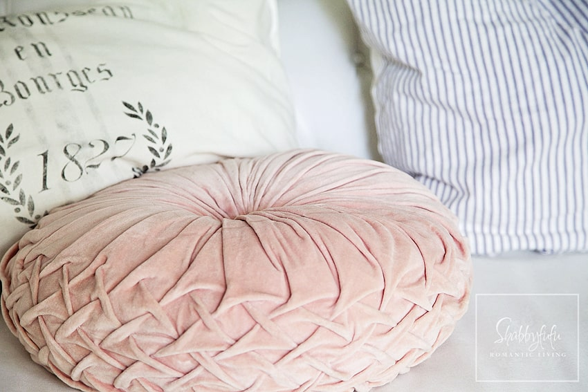 This beautiful soft, pastel pink throw pillow is perfect if you're trying to mix and match throw pillows - it goes with everything!