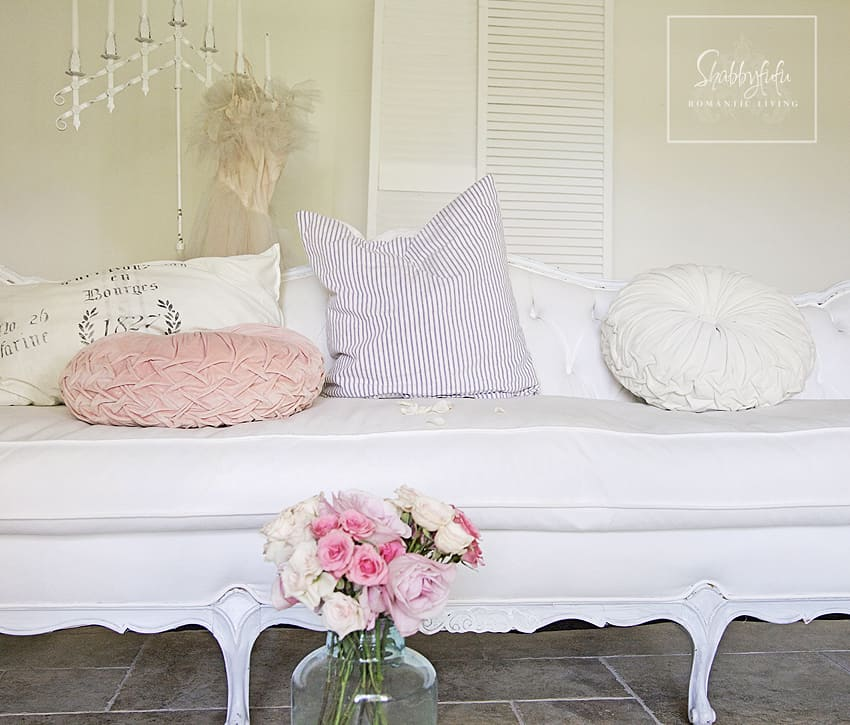 This softer ton of mix and match throw pillows is more on the pastel side with light pink, purple, and white fabrics.