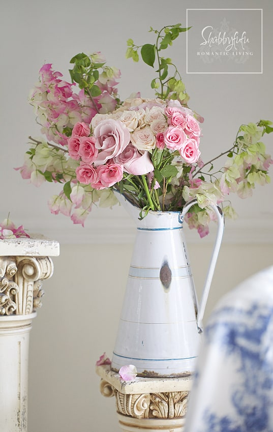 Decorating with toile - this bright pink rose flower arrangement is the perfect contrast with the blue toile