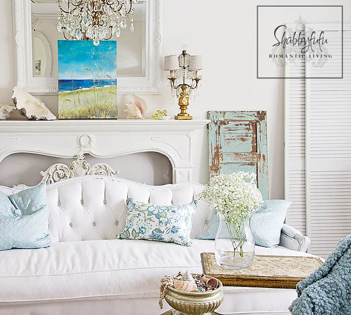decorating with white - you can accent white decor with any color! Here is a white living room scene accented with coastal blues and green