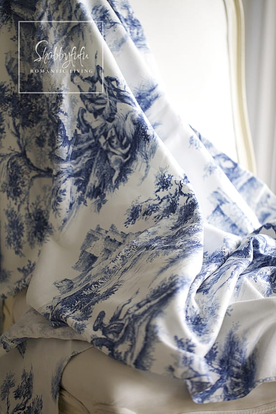 Decorating with toile - detail on blue toile curtains