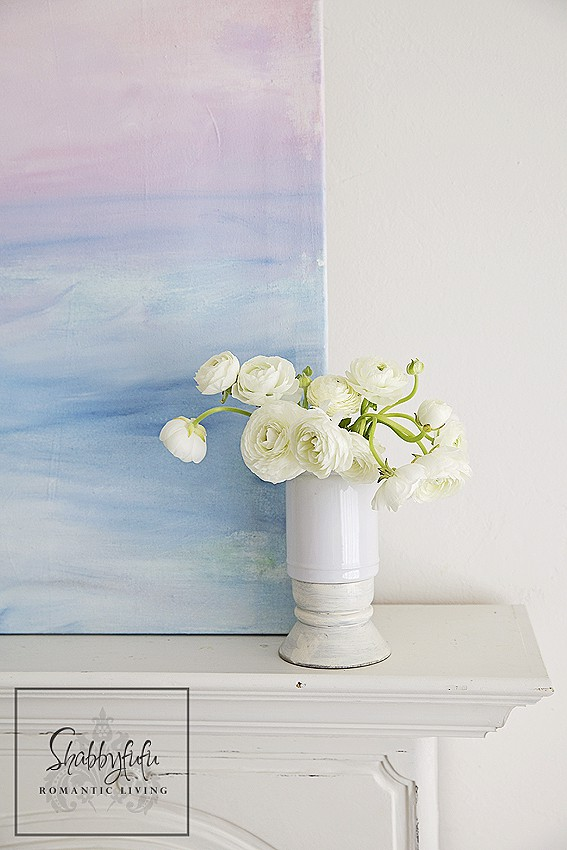 The finished DIY canvas painting has a nice summery texture and the colors blend perfectly together to create an abstract pastel coastal horizon.