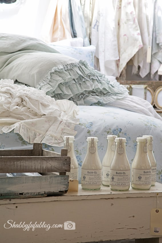 Light, pastel green and white linen display at Shabby Chic Couture. These linens are perfect for a shabby chic style home.
