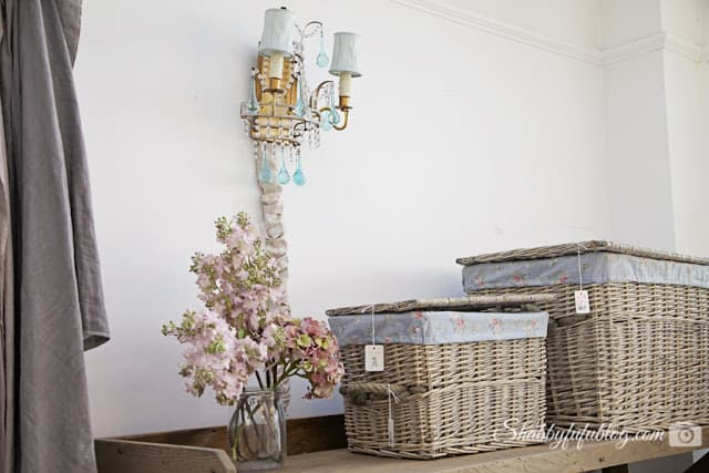 White-washed wicker baskets and a blue crystal wall sconce from Shabby Chic Couture - my favorite shabby chic style boutique.