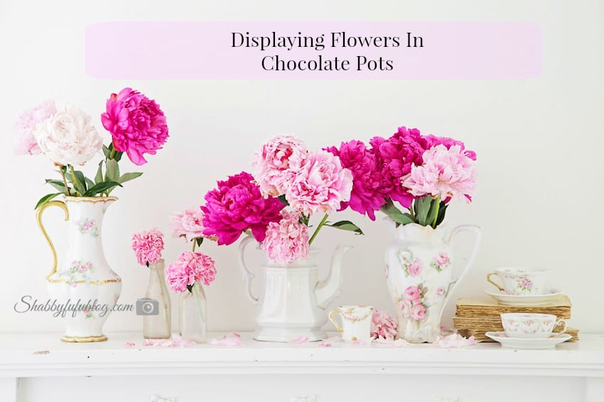 flowers in jars and chocolate pots