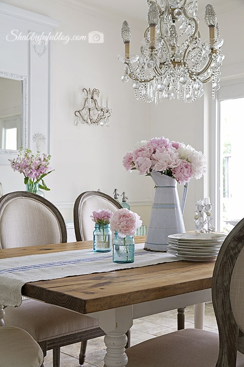 dining room table with peonies
