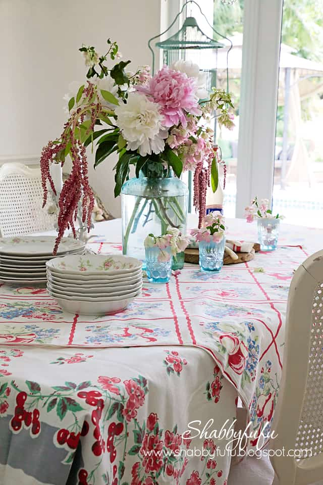 floral arrangement with vintage tablecloths