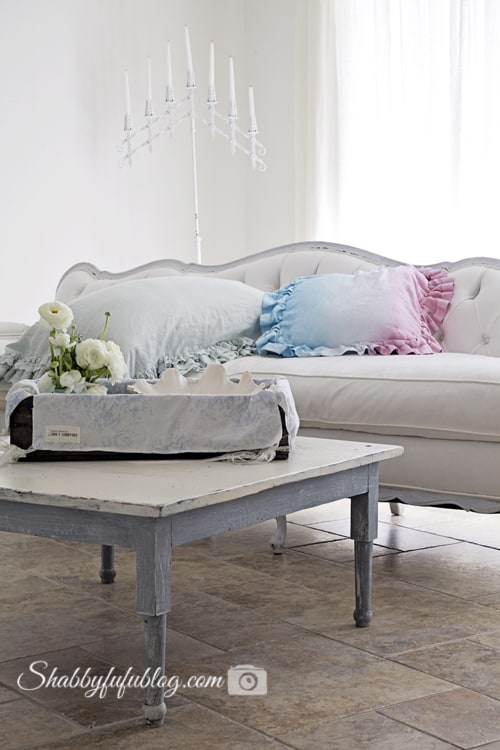 pale blue coffee table button tufted French sofa