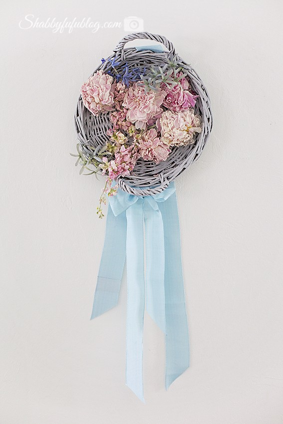 My DIY floral peony wreath - made with a soft grey wicker tray, pastel pink and white peony flowers and a beautiful soft robin's egg blue ribbon.