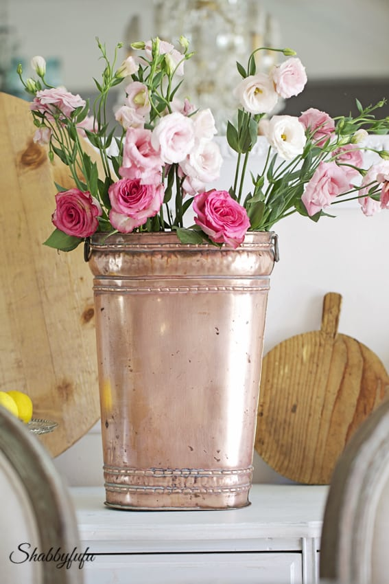 copper planter with flowers
