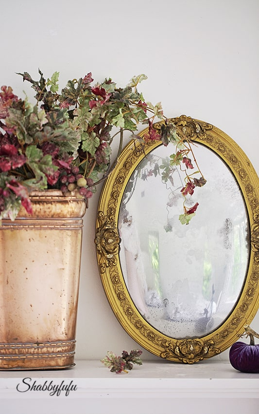 fireplace mantel for fall with copper and gold