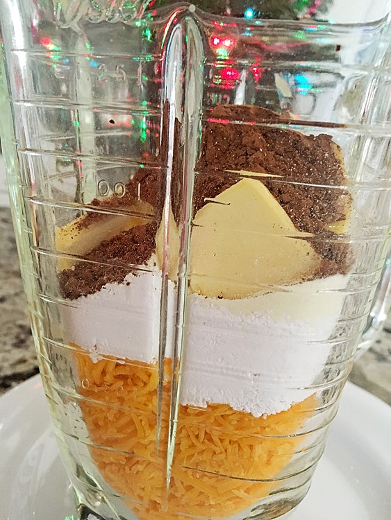blender with cheese ingredients