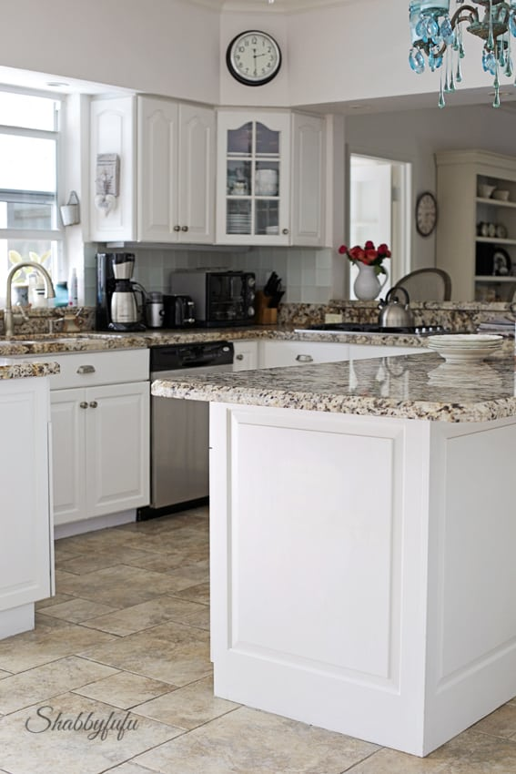 white designer kitchen done on a budget by refacing cabinets with new doors and more