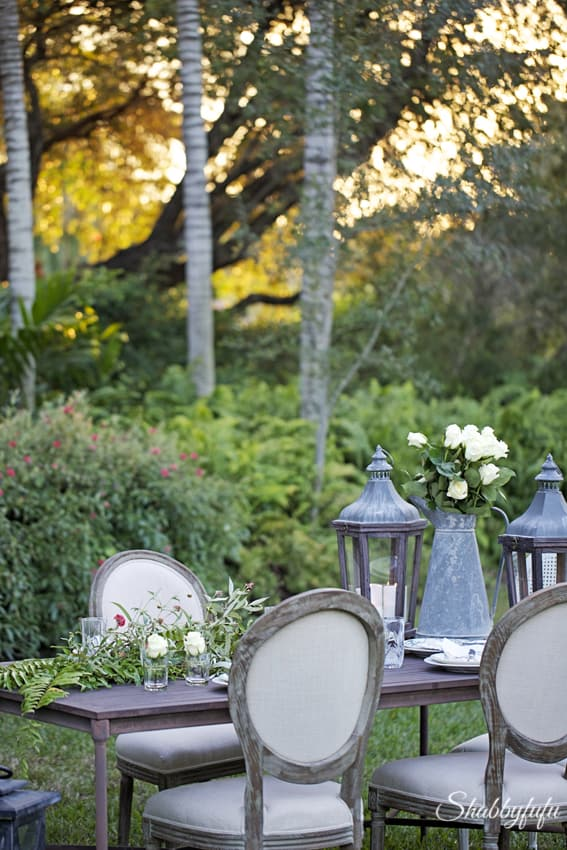 outdoor entertaining with rustic fern garland
