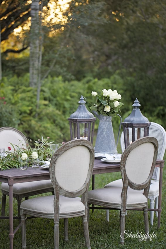 french chairs lanterns outdoor entertaining