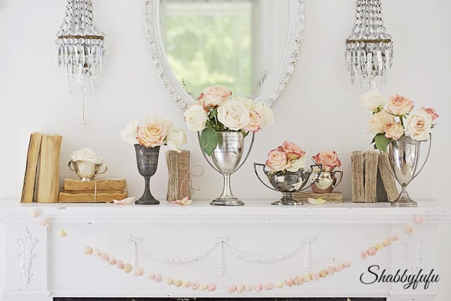 vintage books trophy cups and flowers