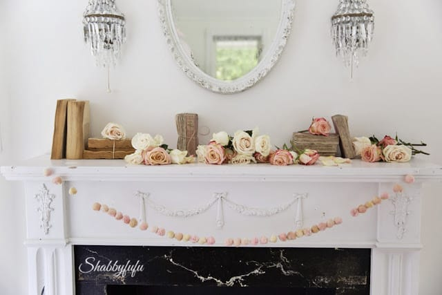 french country mantel with flowers