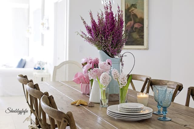 farmhouse table set with flowers
