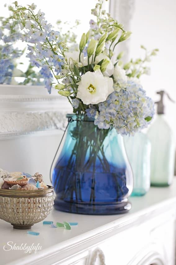 flower arrangement in blue vase