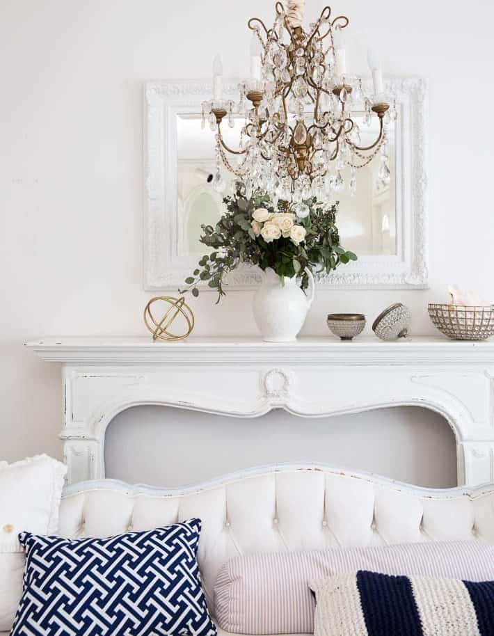 white living room with white and navy blue and gold