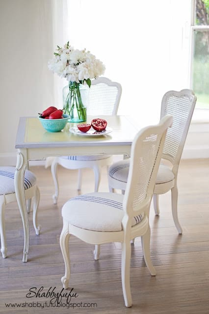 blue and white grainsack on french chairs