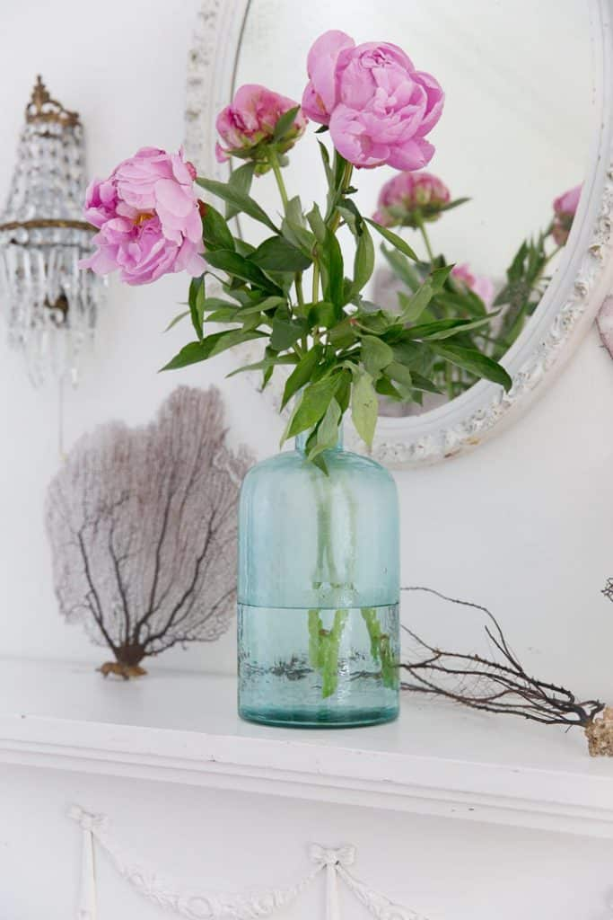 pink peonies in a blue bottle